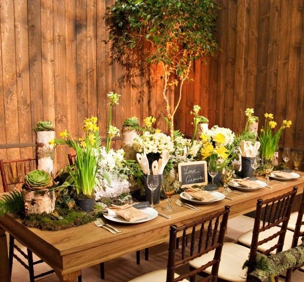Moss, birch and florals create a Rustic table scape