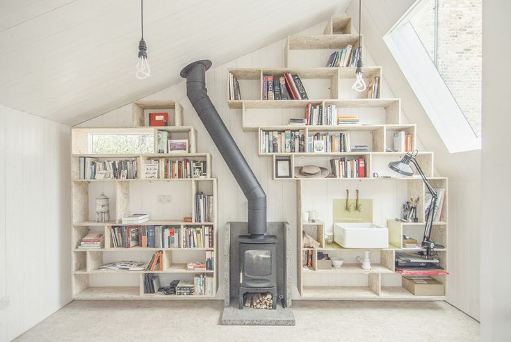 The chimney, rather than shooting straight up as would be expected, creates a great moment when it tilts and runs aslant - Writer's Shed / WSD Architecture