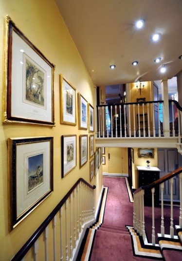 A hallway at Michael Winner's house - another space filled with artworks