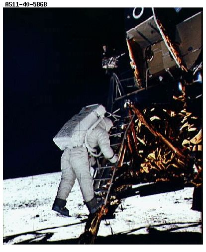 Neil Armstrong emerging from Apollo 11 spacecraft///Lol. Who took the picture, Moon Men? Its Aldrin.