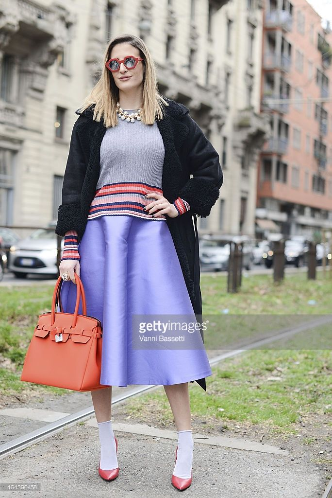 Silvia Torassa poses wearing a Blancha coat Parosh skirt and Save My Bag bag on February 25, 2015 in Milan, Italy.