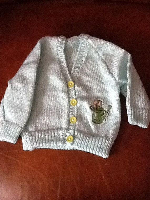 Green hand knitted baby cardigan with by Happilyevercrafts on Etsy, £12.00