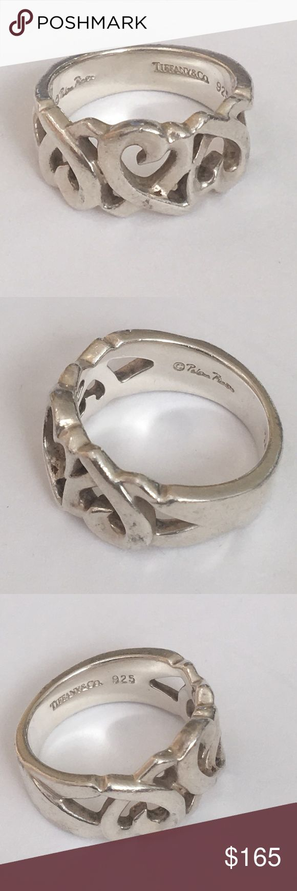 Tiffany Sterling Paloma Picasso Open Heart Ring This is an authentic sterling silver ring design by Paloma Picasso for Tiffany. It is a size 4 1/2 and can be sized by a jeweler, but that will cut into the hallmarks in the back of the ring. The ring is marked Tiffany and Company, 925, and Paloma Picasso. This is currently available on Tiffany's website for $200. Tiffany & Co. Jewelry Rings