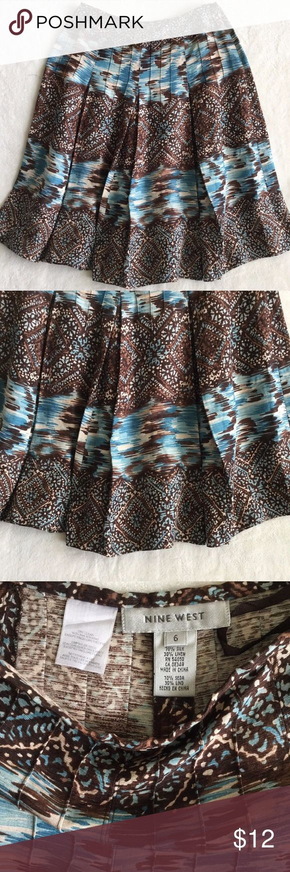 "Nine West Skirt Size 6 Lined This is a beautiful blue, brown, and cream print pleated skirt.  Brand: Nine West Size: 6 Material: 70% Silk, 30% Linen Waist: 15"" across Length: 26 1/2"" long  Excellent condition. Nine West Skirts"