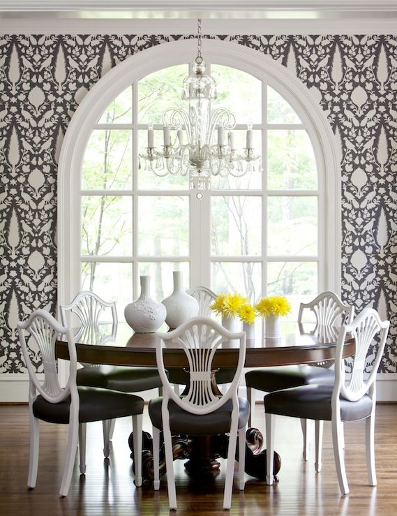 Love the wallpaper and how the yellow flowers add the pop of color to the black and white!
