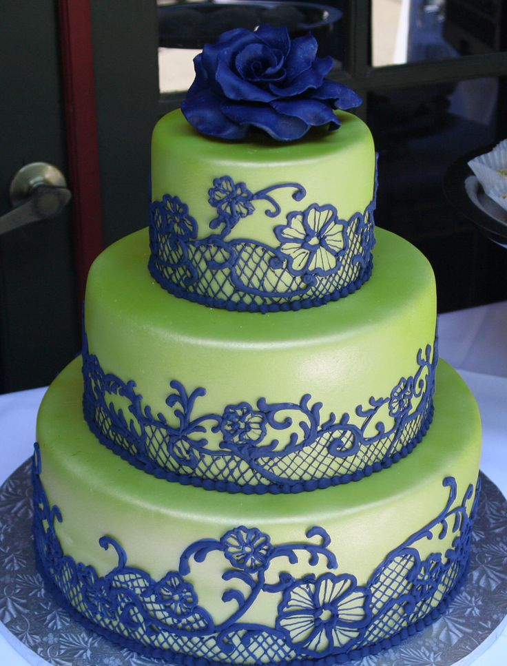 lime green and navy wedding cake - I'd prefer white to lime green, I love the look of the lace though!