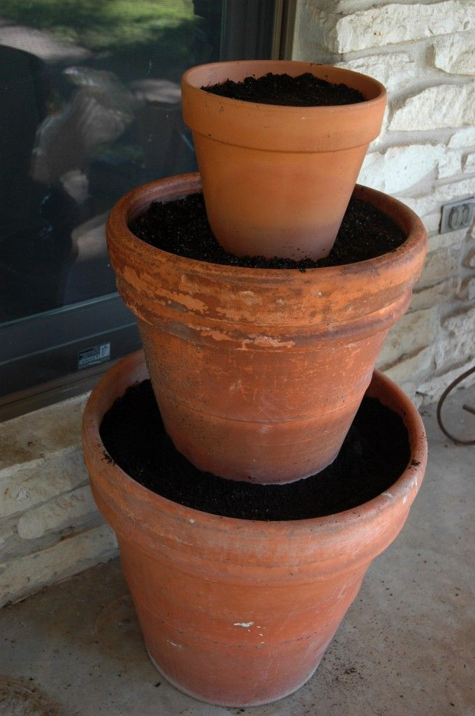 How To Create a 3-Tiered Planter. Will  not require as much dirt as it looks like as you place a plastic nursery pot in the large one.  I'd like to use it for salad and herbs.