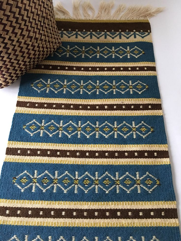 Dhurrie rugs are charming when draped over a bench or chair.  https://www.etsy.com/listing/497396144/vintage-blue-brown-small-dhurrie-rug