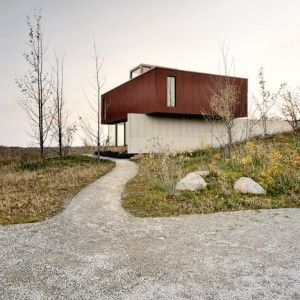 Williamson Chong's House in Frogs Hollow  burrows into the Ontario landscape