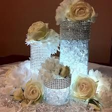 Diamond centerpieces. Just fill different sized vases (from the dollar store) with absorbent jelly . Add color water proof LED light to the bottom.