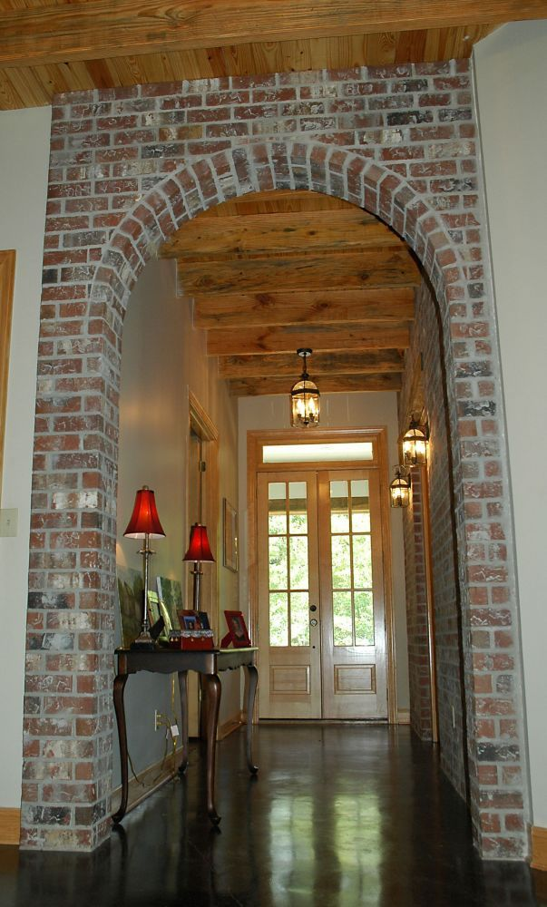 archway made of different material than walls to break up the space and make it look less long