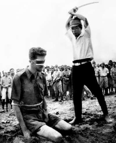 Japanese Officer Chikao Yasuno prepares to decapitate Australian Sergeant Leonard George Siffleet in 1943.  US troops found this photo on the body of a dead Japanese man in 1944