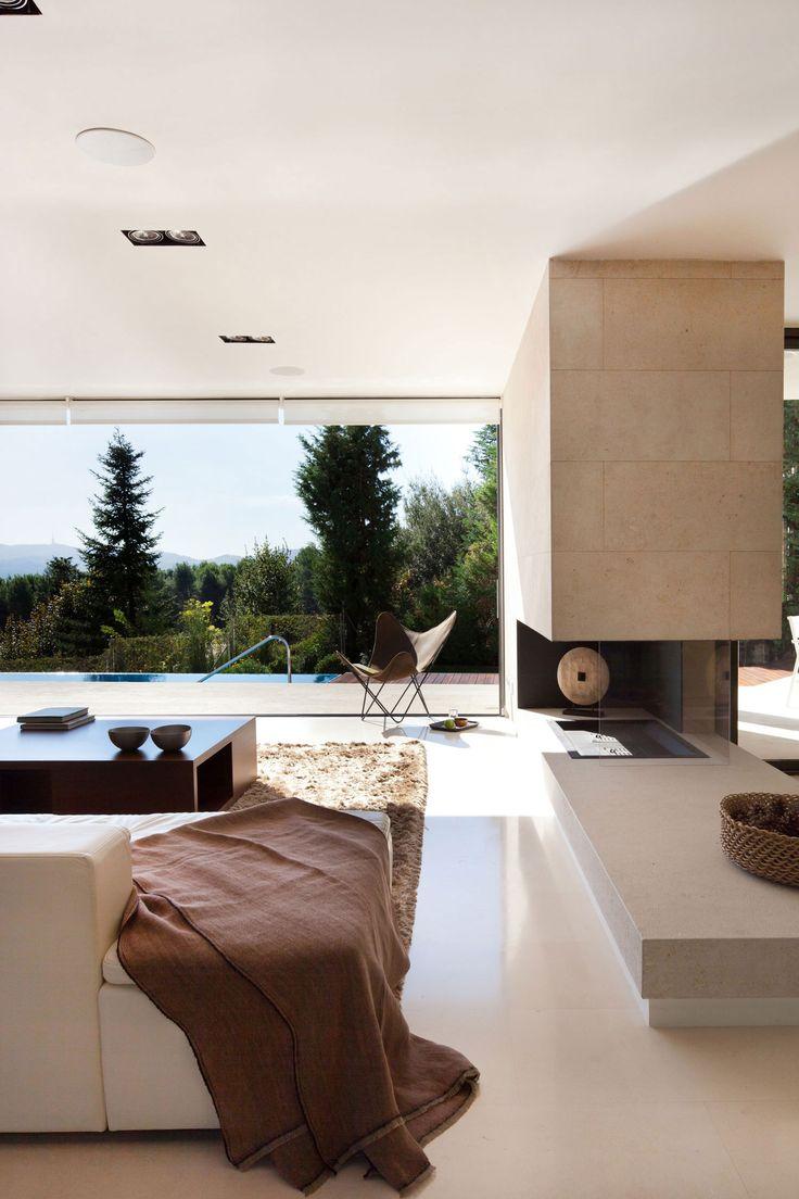 3 sided fireplace, brilliant House Rehabilitation in Cerdanyola del Vallès, Spain