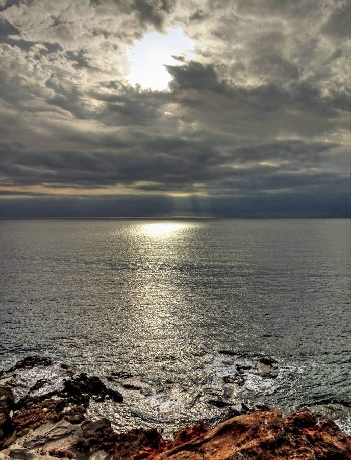 Hole in the sky - cloudy day at the seaside in Porto Ferro