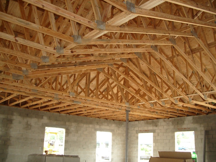 Scissor truss before drywall exposed roof trusses for Exposed roof trusses images