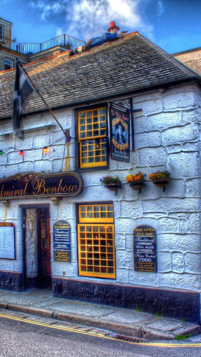 The Admial Benbow Pub in Penzance, Cornwall, UK - memories of childhood holidays in the area which included pub visits for a pint and a pack of bullion or in my case, a coke and a packet of crisps - been here a few times and always with the guy on the roof.