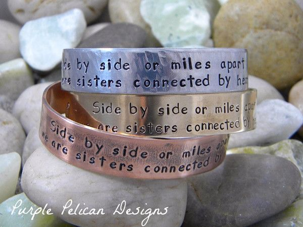 "Sister Bracelet - Side by side or miles apart we are sisters connected by heart...This is a sweet way to remind your sister that no matter how far apart life takes you, you are always together in heart. It says ""Side by side or miles apart, we are sisters connected by heart.""  Available in sterling silver, copper, brass, and aluminum."