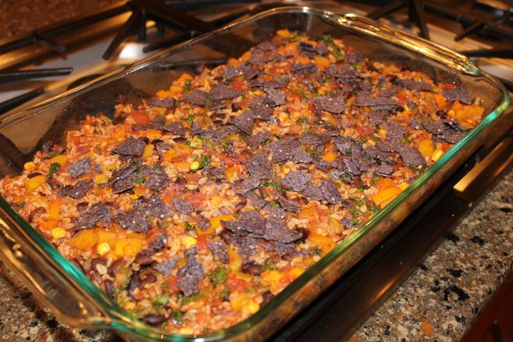 Crowd pleasing tex mex casserole {from Oh She Glows} - has bell peppers, tomatoes, corn, kale/spinach, black beans, rice, cheese and chips. {party and freezer friendly} Would be easy to change up by using your own salsa instead of the seasoning mix