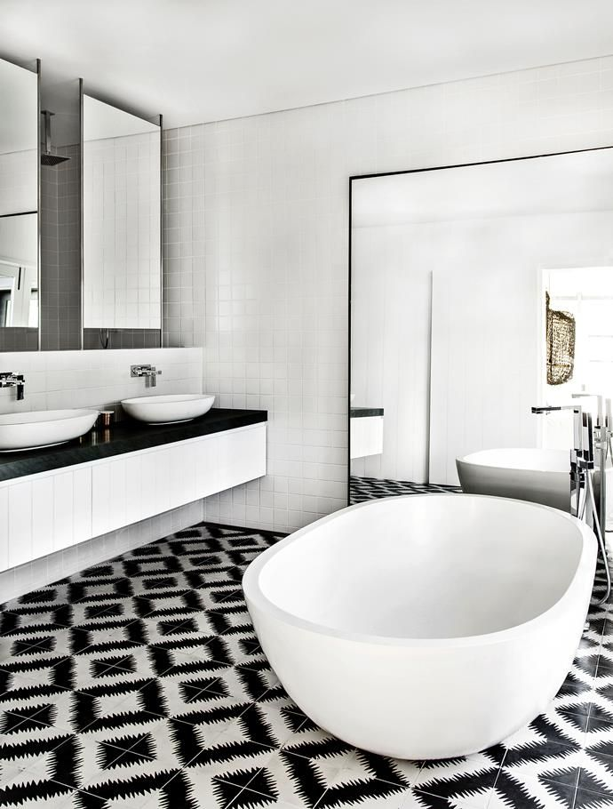 Graphic black and white tiles add drama to the main bedroom's ensuite. | Photo: Felix Forest  | Story: Belle
