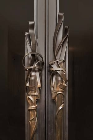 We love Albert Paley, and used these Bronze Door Handles in a wine cellar for a client. #hardware #interiordesign #jpwarreninteriors