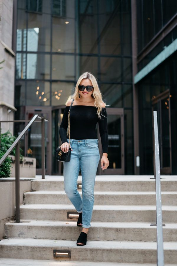 What to Wear Out: Black Bodysuit + Jeans — bows & sequins. Black off the shoulder bodysuit+boyfriend jeans+black suede mules+black chain shoulder bag+sunglasses+white and black tassel earrings. Spring Evening Going Out Outfit 2017