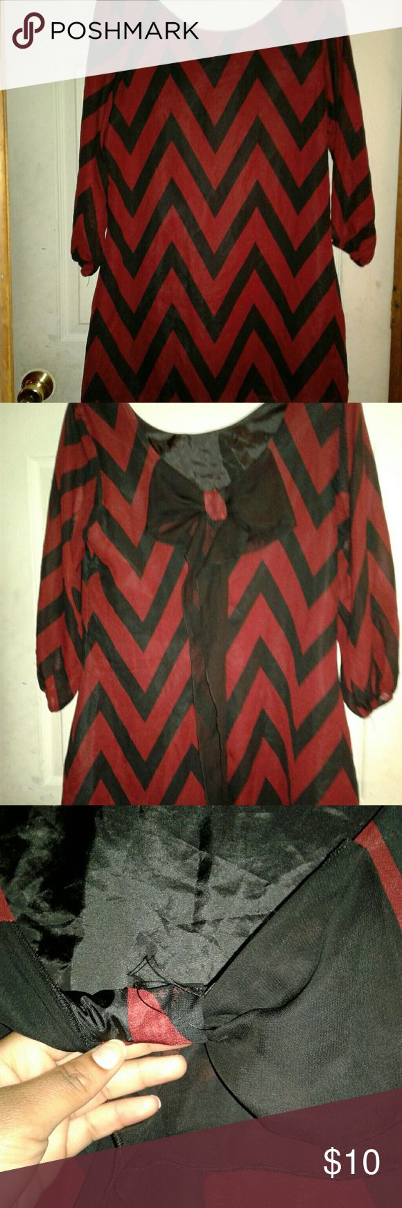 Chick chevron blouse Navy blue and burgundy chevron blouse with bow at the back. Worn 2x. Has strings hanging on the inside of short. Def unnoticeable but thought I would mention Tops