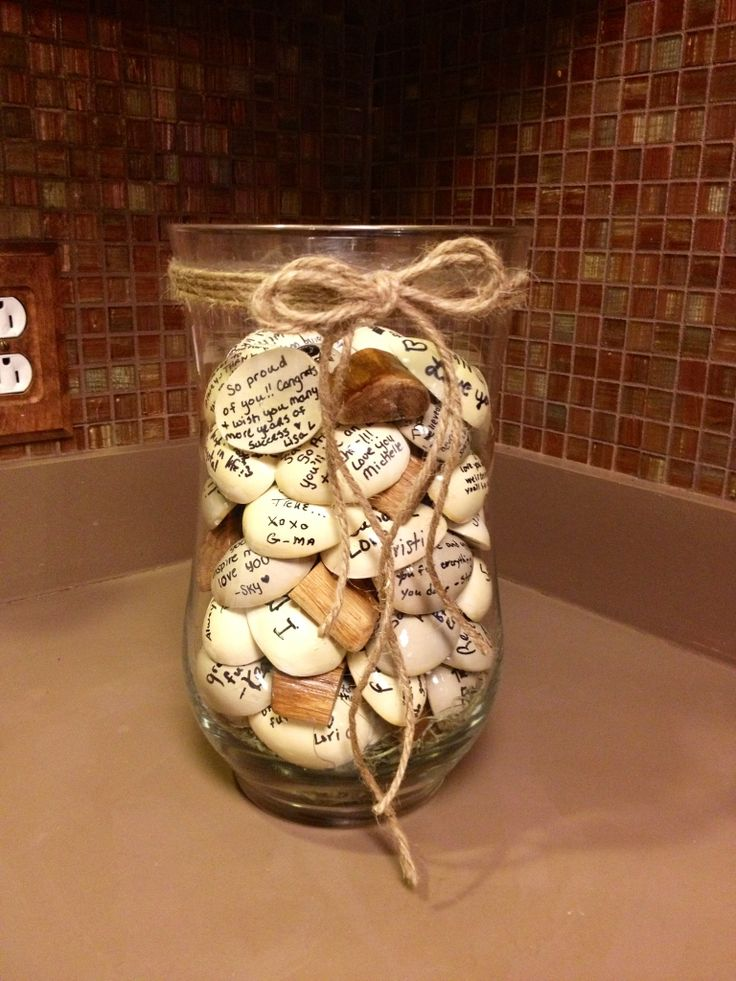 my mom put this together for my graduation! a vase with messages written on rocks from everyone! #graduation #DIY