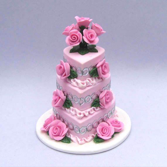 1:12 polymer clay Three tier pink heart shaped dollhouse miniature wedding cake handmade by BlueKittyMiniatures. $32.00, via Etsy.