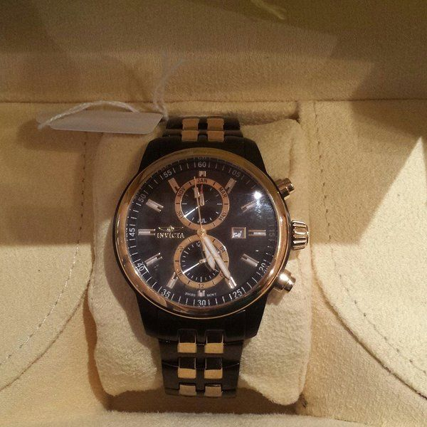 Man's Black and Gold Watch