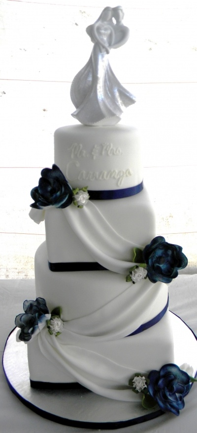 Navy blue and white wedding cake. Love the drapery, change the colors to lime green & sky blue & then but the letter B on top & it would be perfect.