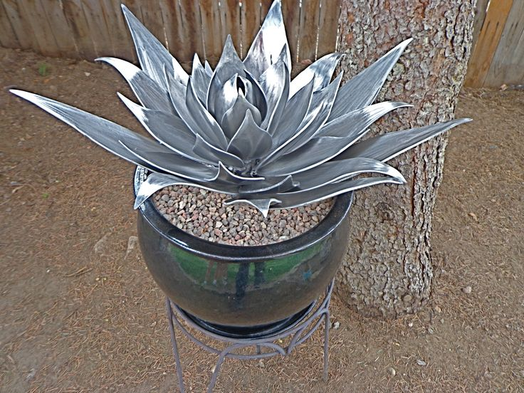 "This aluminum Agave Cactus plant was hand cut, shaped and welded. It measures 22"" across and stands 14"" tall. It is for sale!"