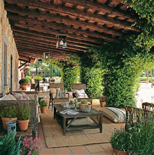 summer dining room - love the jasmine - 17th century farmhouse in Catalonia, Spain