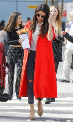 Selena Gomez fancies a bright red coat and leopard heels for an arrival in London. September 20, 2015.