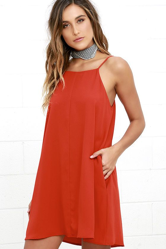 The Clarion Call Red Dress has issued an urgent order ... to go hit the dance floor and have a good time! A high, apron neckline (supported by adjustable spaghetti straps) tops off this woven poly swing dress. Hidden side pockets.