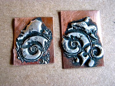 All you need is solder, copper sheet and your torch! Heat up the solder and put a rubber stamp in it and walla you have these pendants. Very cool!