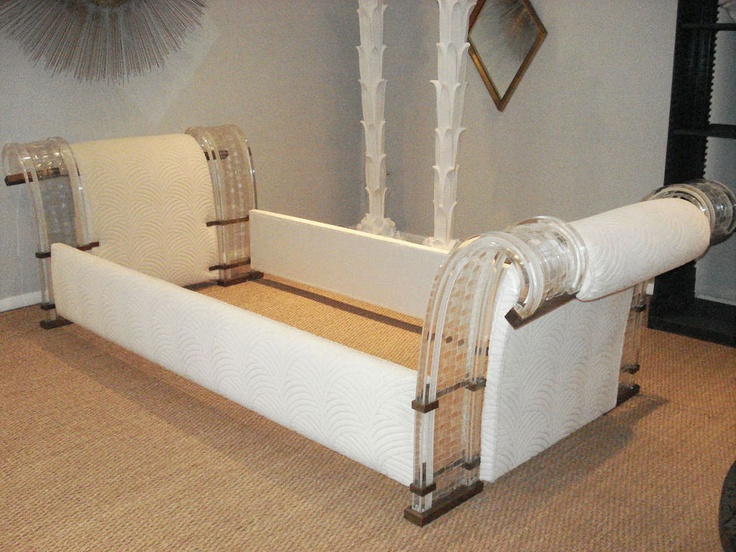 such a cool bed frame. Lucite White girls bedroom bed.