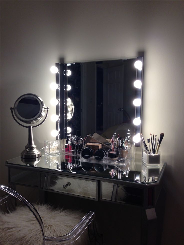 vanity area with lighted mirror