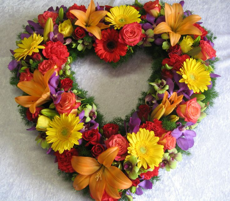 Stunning Love Heart full of seasonal flowers and foliages. Great to float in a pool or sit near a love seat