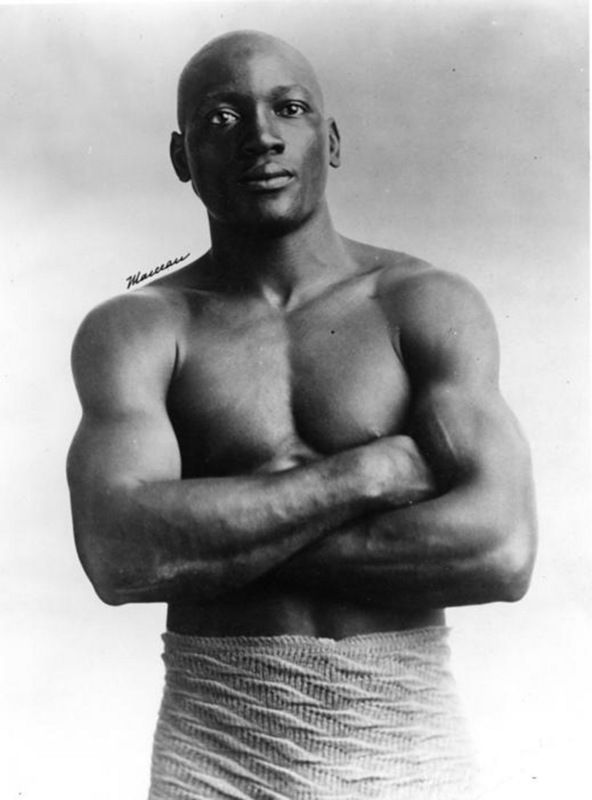 Jack Johnson, the first African American world heavyweight boxing champion. Looking sharp with the use of minimal clothing.