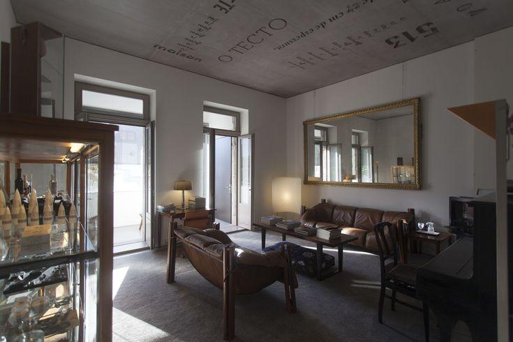 Vintage brown leather sofas. Vintage mirror. Concrete ceiling. Casa do Conto   Porto   Portugal    JO&SO Collection