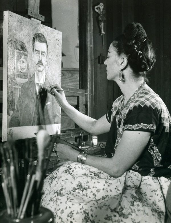 Frida Kahlo painting the portrait of her father, 1951, Photograph: Gisèle Freund © Banco de México. Fideicomiso Museos Diego Rivera y Frida Kahlo.
