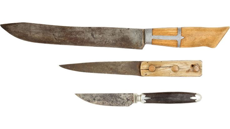 Frontier utility knives: a butcher knife, a skinning knife, and a small antique paring knife.  15 Tools That Helped Pioneers Survive on the American Frontier