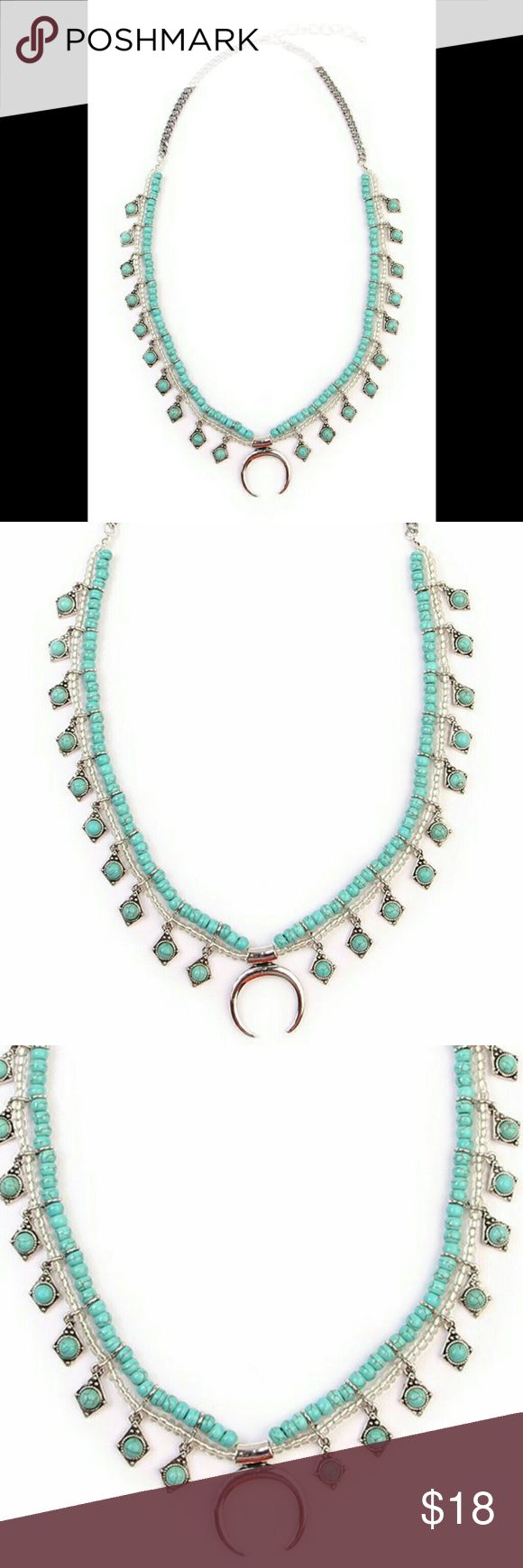 """TURQUOISE SQUASH BLOSSOM NECKLACE Vintage inspired squash blossom necklace is the perfect accessory for all your boho chic outfits. Look like a rock star in this silver tone statement necklace! Material:?Base Metal, Turquoise Stones, CC Beads Closure:?Lobster Clasp ?Measurement:??3"""" Extender, 20"""" Length, Decor 1.5"""" L x 1.1""""W *??Limit exposure to water, perfume or body cream Jewelry Necklaces"""