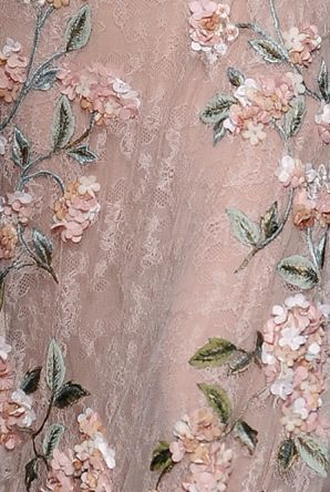 Pale fabric (netting) with three-dimensional pink flowers and vines.