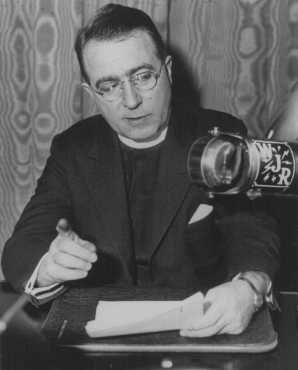 Father Charles Coughlin, leader of the antisemitic Christian Front, delivers a radio broadcast. Detroit, United States, March 11, 1935.