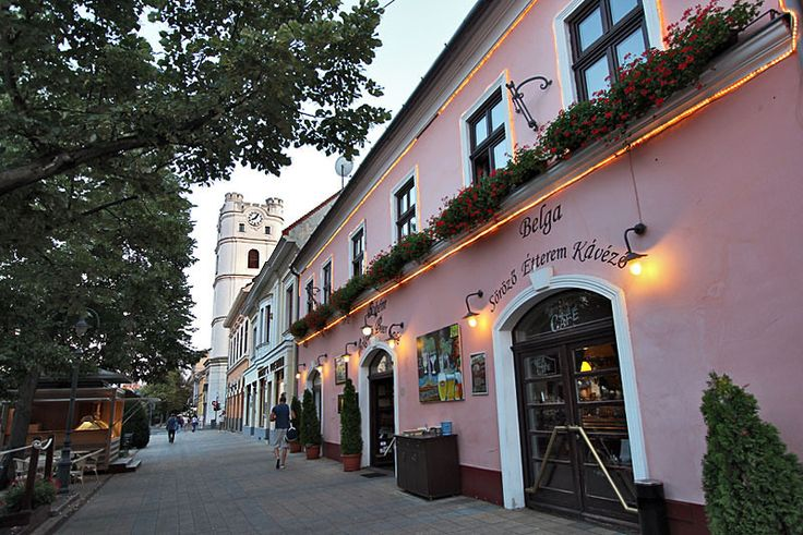 Piac Street in Debrecen, Hungary, with Reformatus Kistemplom tower in the background