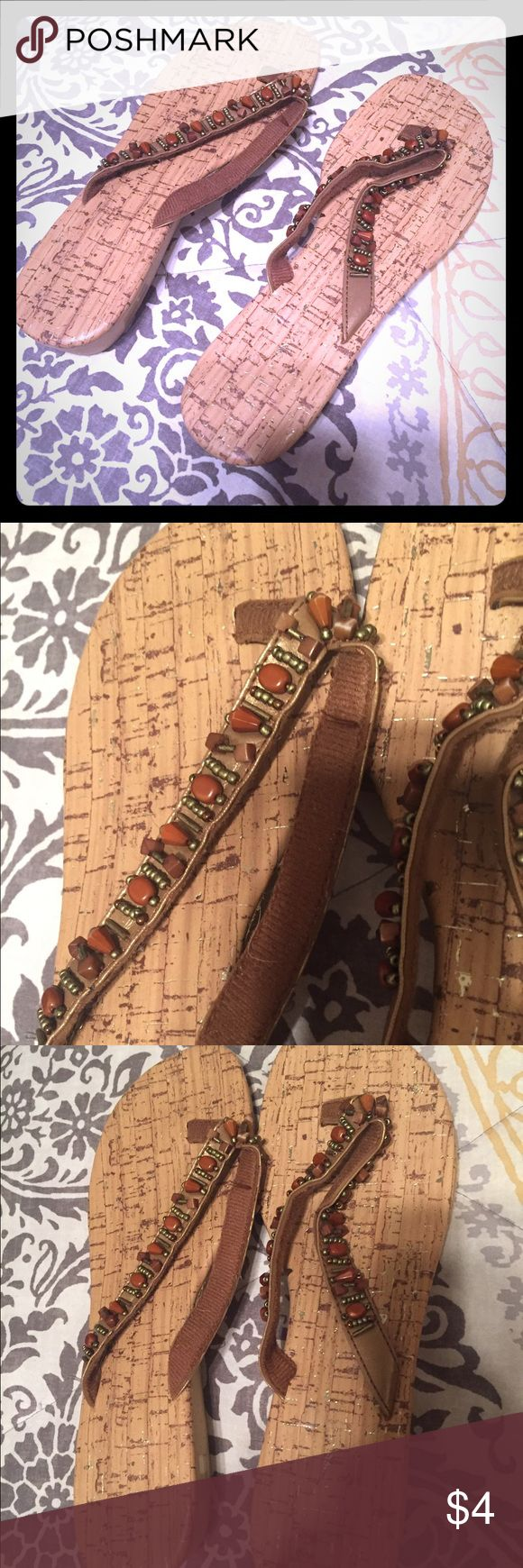 Beaded sandals. Cork, beaded sandals.  I'm not what sure what brand they are; I only wore them maybe once inside.  They've been being stored.  I feel like I got them at Maurice's or gordmans.  Size 8. Very cute and like new. Shoes Sandals