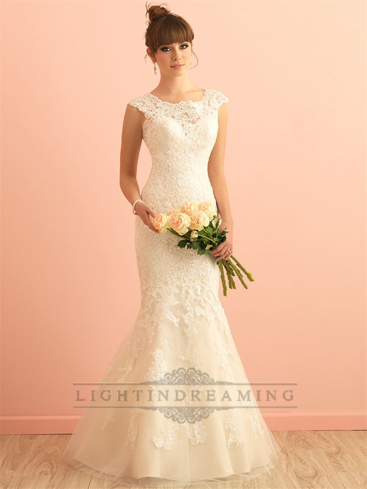 A softly scooped neckline and gorgeous back detailing are featured in this lace gown.
