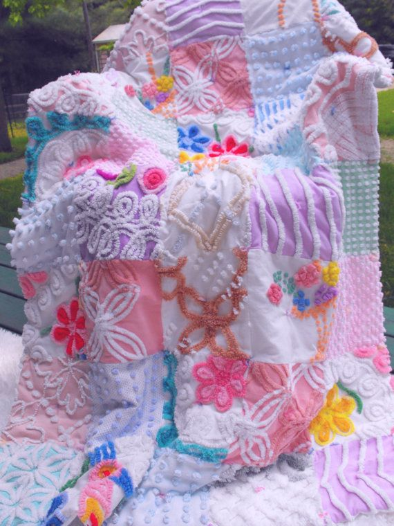 A chenille patchwork quilt! Absolutely gorgeous super fluffy and plush vintage chenille patchwork throw quilt in beautiful shades of pink, green, blue, purple, candy red, yellow, orange, aqua. brown, rose and white. This gorgeous quilt has popcorns, loop-d-loops, ton of flowers, squiggle, lines,lattice, pearls, daisy, wedding ring and swirls.