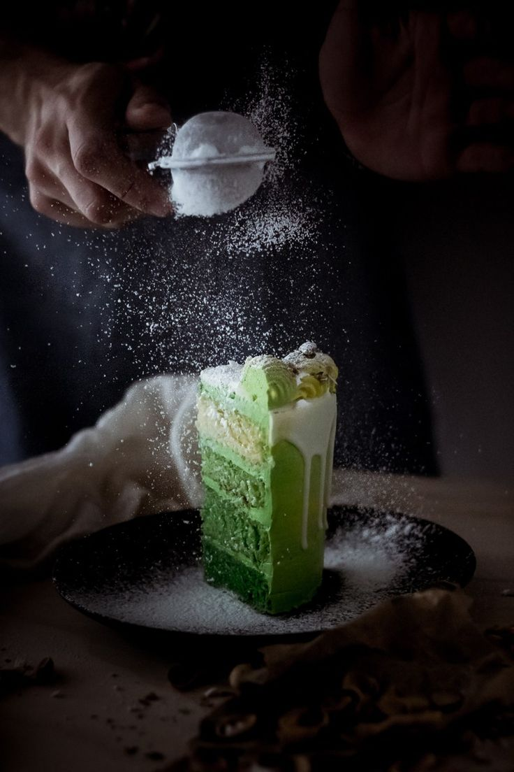 green pistachio cake and white chocolate drip